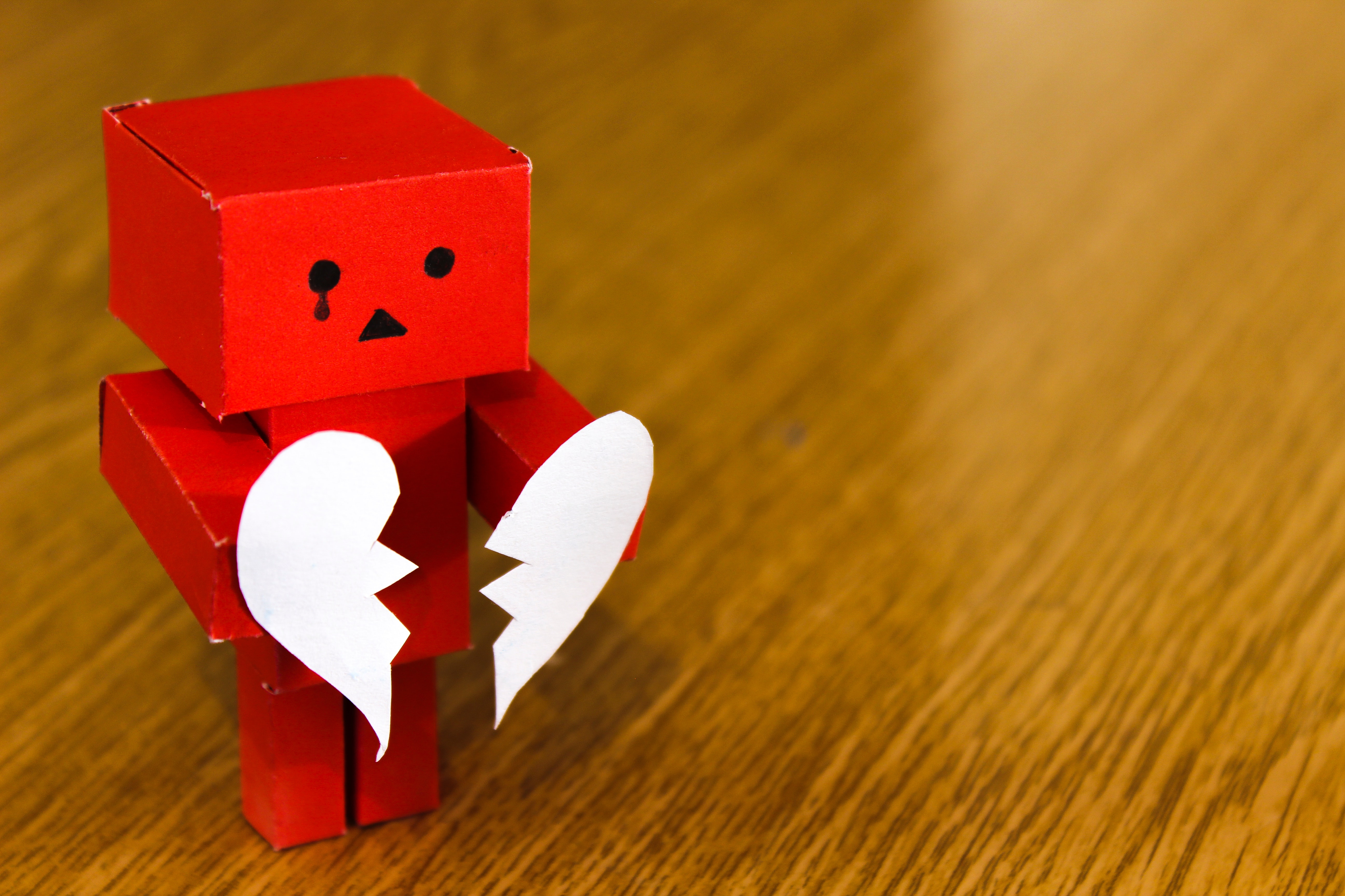 Crying robot with broken heart