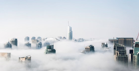 Clouds covering a cityscape