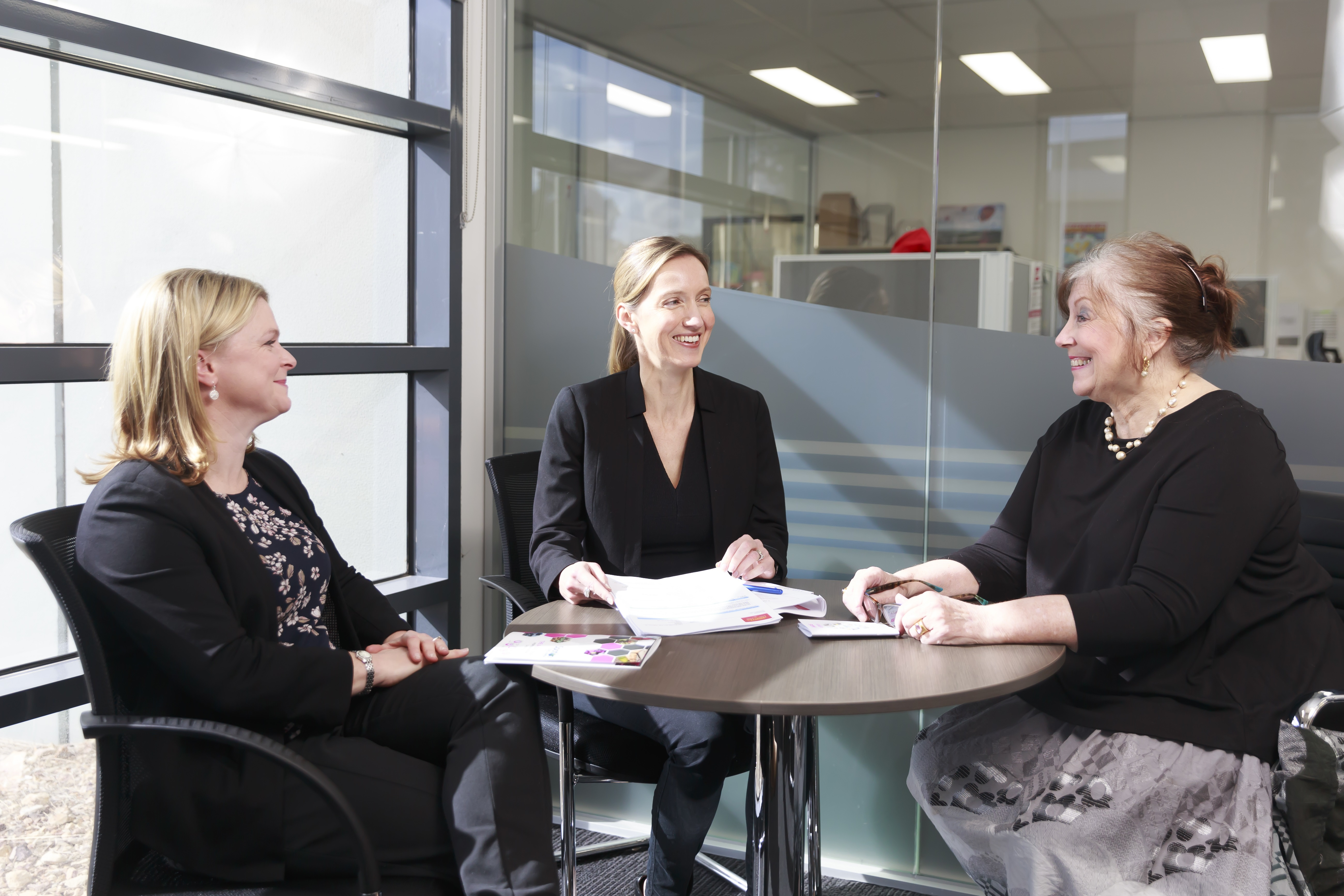 Three people in meeting