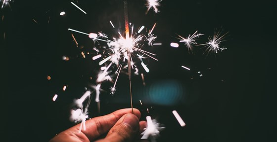 Sparkler being held by someones hand