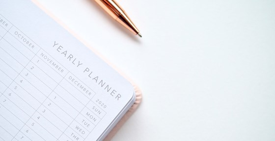 Calendar planner with pen on table