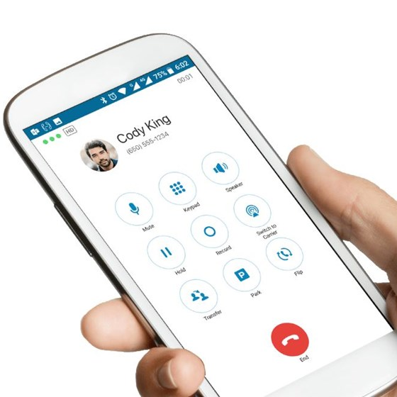 Hand holding mobile phone with RingCentral