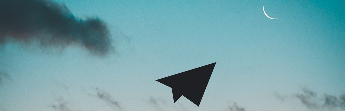 Man throwing a paper plane in the sky