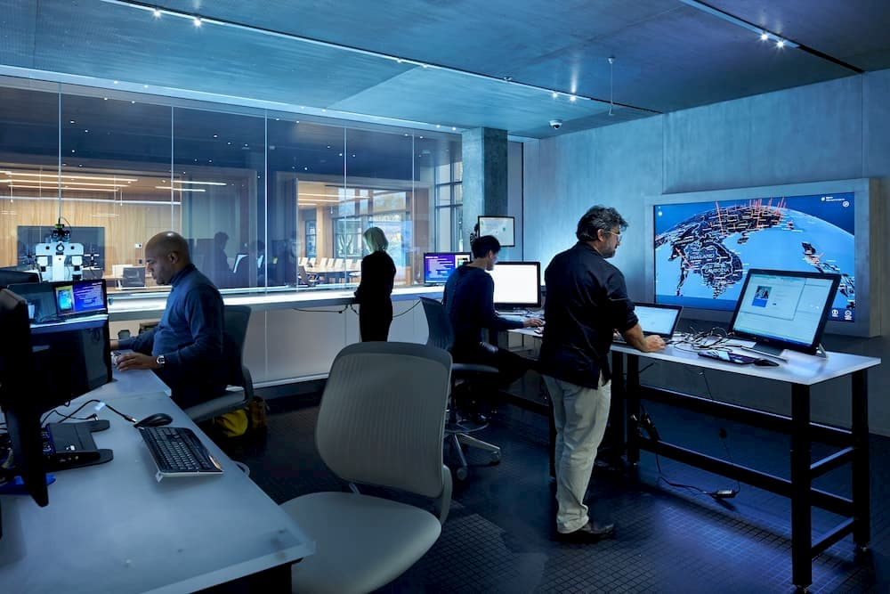 People working in a cyber security lab