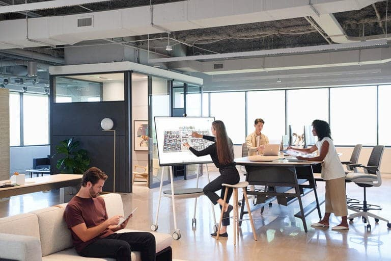 Modern workplace with people working in open plan office